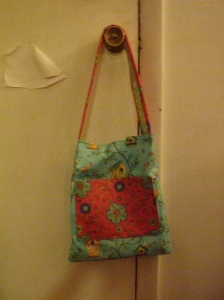 Cute blue birdy bag with bright pink pocket!
