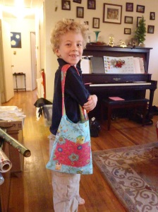 A proud boy with the bag he made!