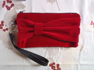 A Marilyn wristlet in a festive holiday red.