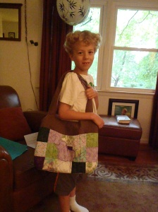E with the bag he created for his teacher, Mrs. A-O.