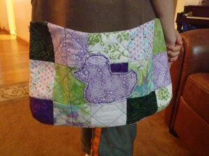 Side one with the cute purple duck.