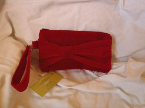 Marilyn! A festive red velvet holiday wristlet. It dresses up your little black dress.  Priced at $35.