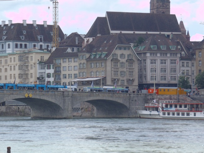 A closer view of the buildings behind the bridge.