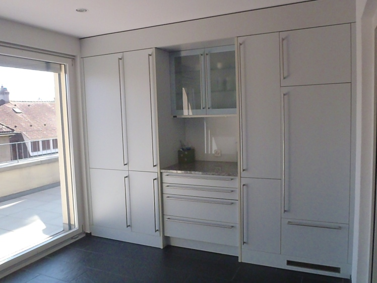 The bank of cupboards in our kitchen. The fridge is also disguised as one of them. (Psst! It's the one on the right!)