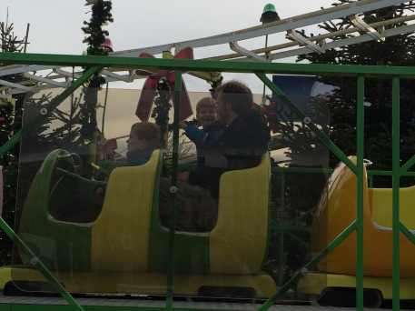 All my kids on a mini roller coaster.