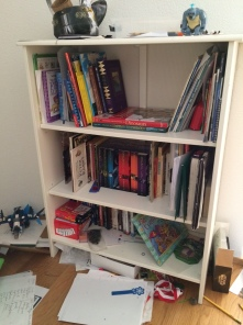 "E's book area.  Loads more are up at his desk and the papers scattered around are different ""project notes.""  Embrace messes."