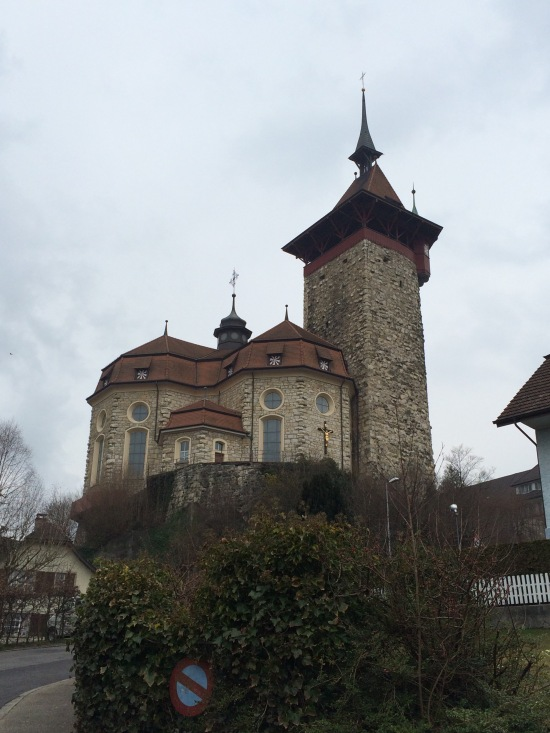 The 12th-century tower connected to the much newer church.