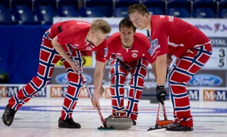 Norway skip Thomas Ulsrud, center, keeps his eye on his shot as Christoffer Svae, right, and Havard Vad Petersson sweep during an morning draw against Scotland at the mens world curling championships in Victoria, British Columbia, Wednesday, April 3, 2013. (AP Photo/The Canadian Press, Jonathan Hayward) ORG XMIT: JOHV117